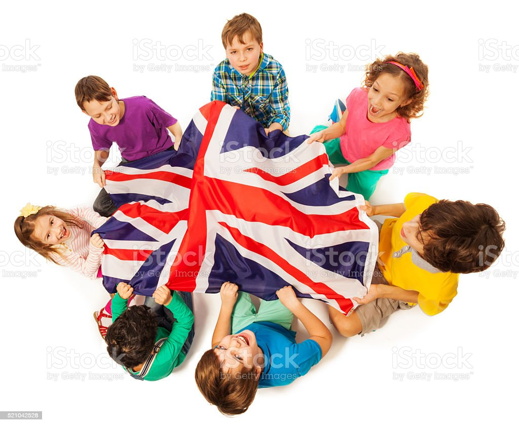 Kids with English flag in a middle of their circle stock photo