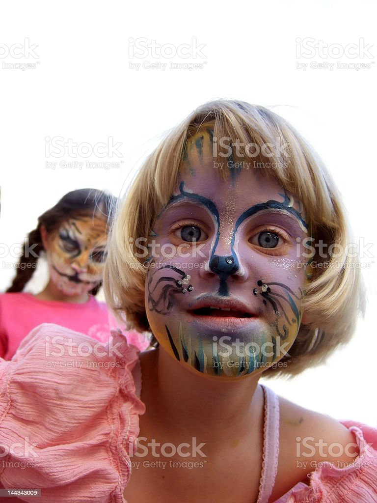 kids with face-makeup as domesticated cats stock photo