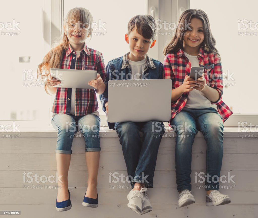 Kids with gadget stock photo