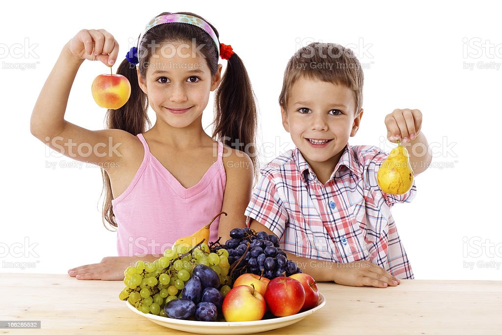 Kids with plate of fruit royalty-free stock photo