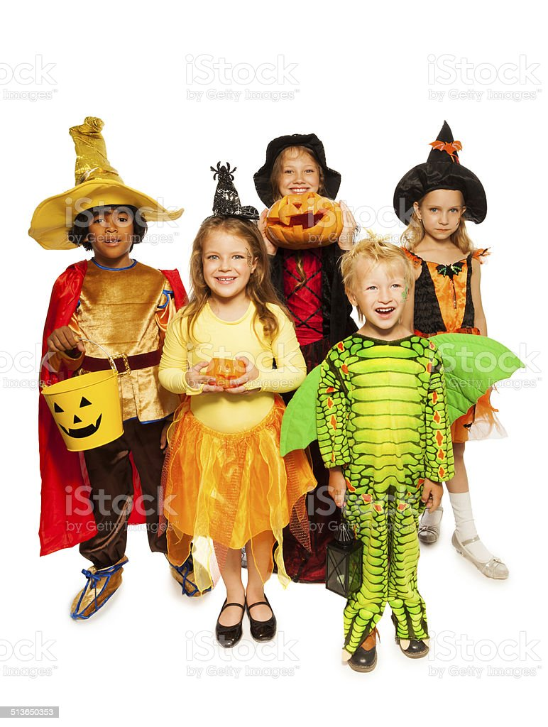 Kids with pumpkin and in Halloween costumes stock photo
