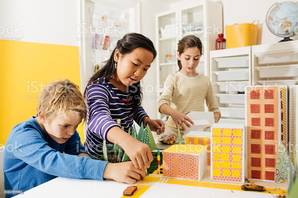 Kids working on a school project stock photo