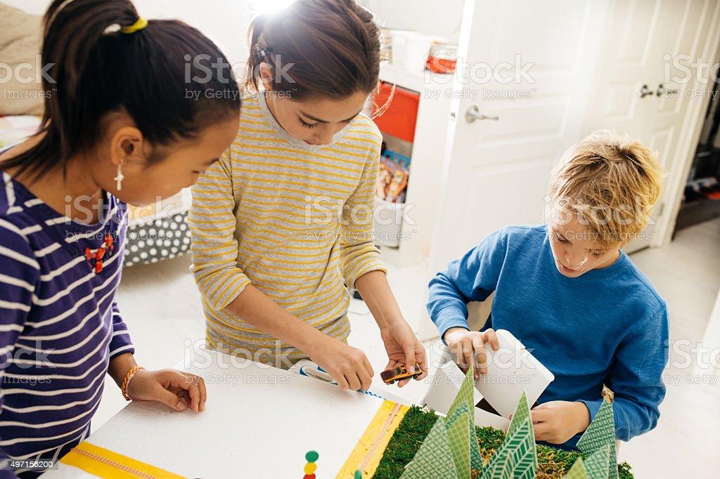 Kids working on school project stock photo