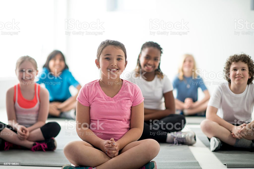 Kids Yoga Class at the Gym stock photo