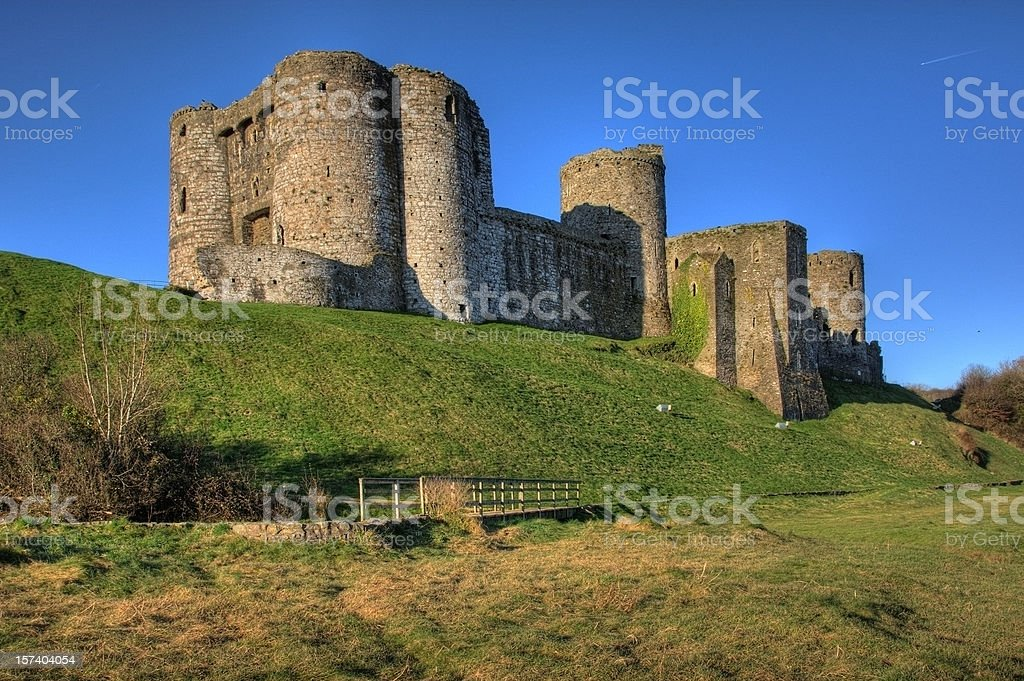 Kidwelly Castle and clear blue sky bridge royalty-free stock photo