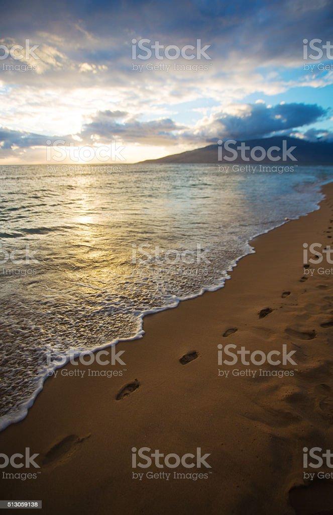 Kihei Sunset and Beach Footprints stock photo