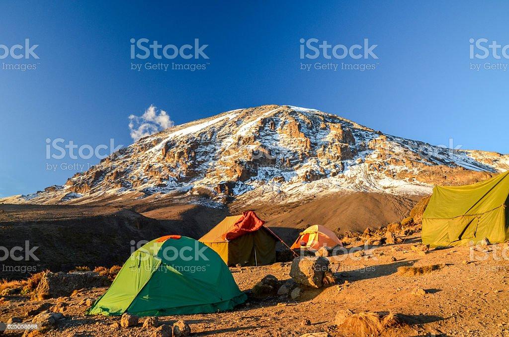 Kilimanjaro and camping tents - Tanzania, Africa stock photo