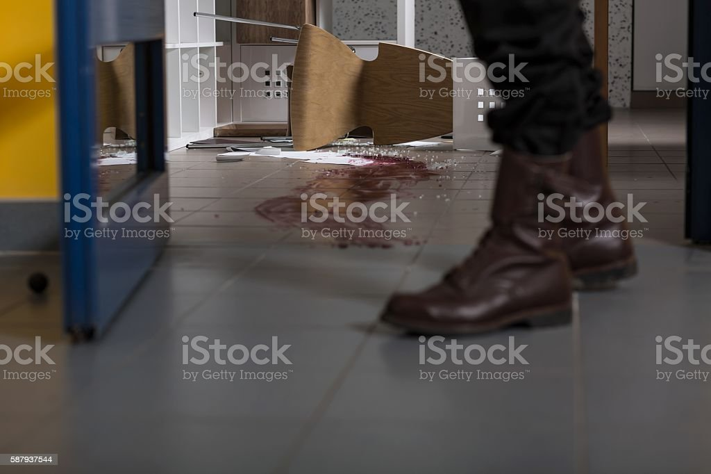 Killer leaving a crime scene... stock photo