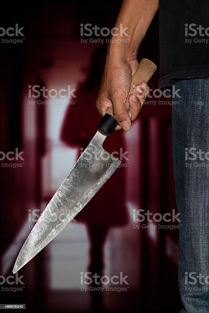 killer person with sharp knife stock photo
