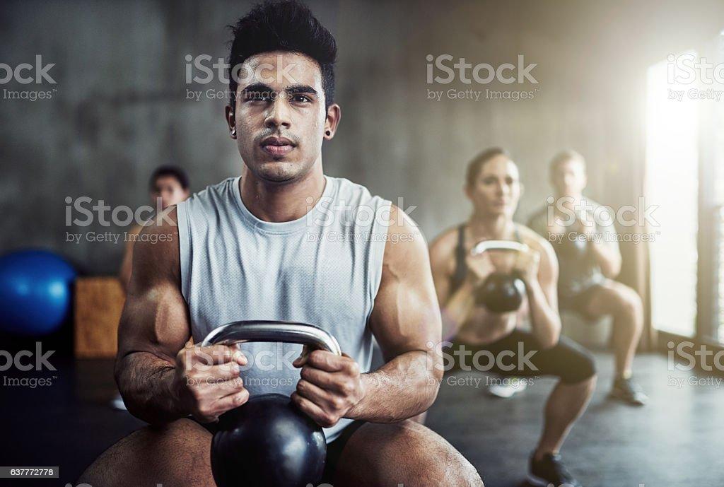 Killing that kettlebell workout stock photo
