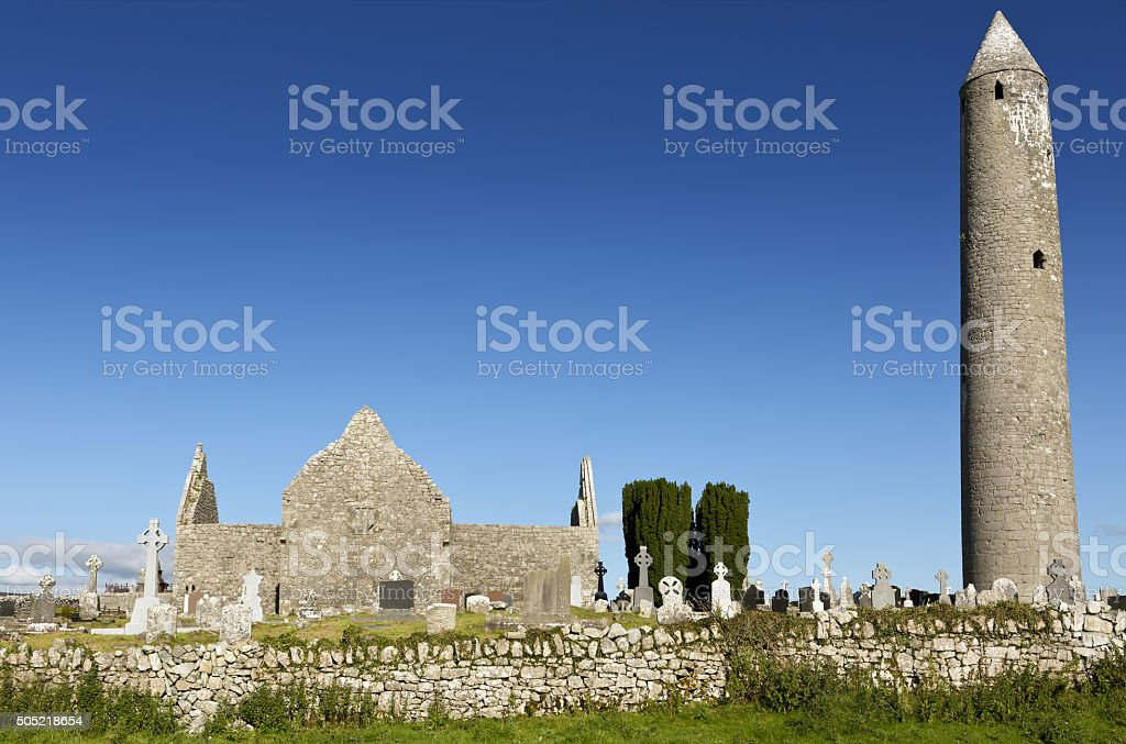 Kilmacduagh monastery with stone tower in Ireland. stock photo