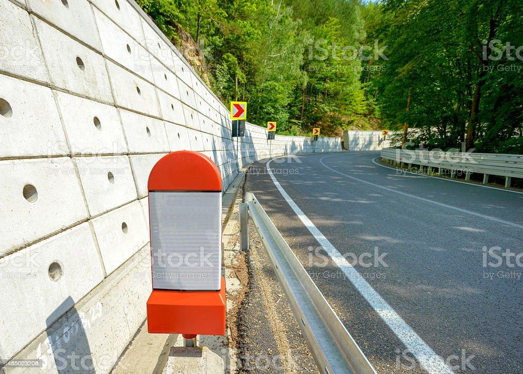 kilometer stone post on the roadside in Romania stock photo