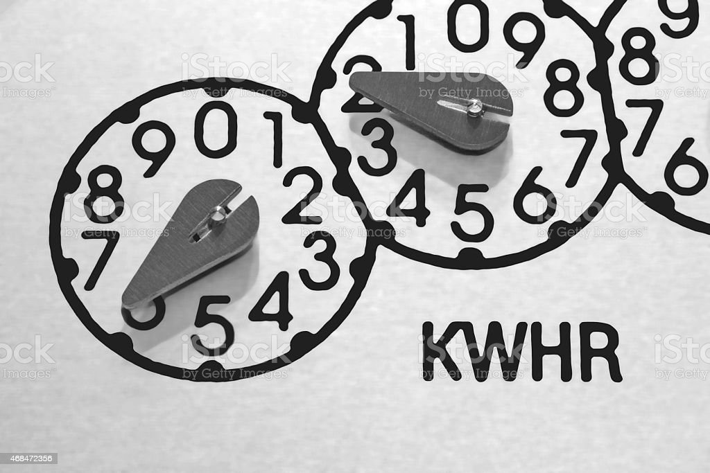kilowatt-hour (kilowatthour) meter dials close-up stock photo