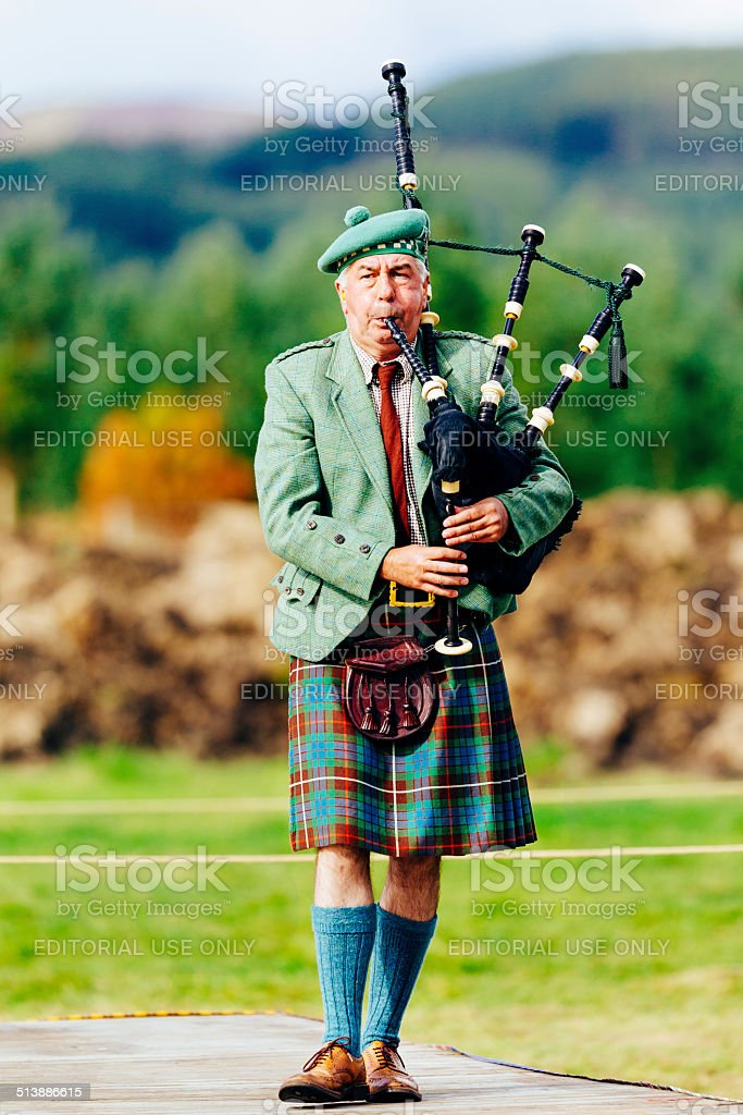 Kilted male scottish piper with bagpipes stock photo