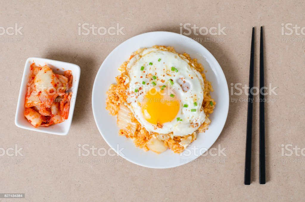 Kimchi fried rice with fried egg on top stock photo