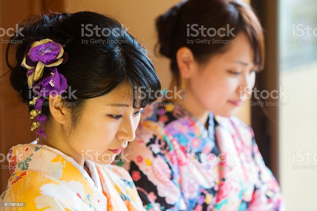 Kimono Wearing Traditional Young Japanese Women in Typical Restaurant stock photo