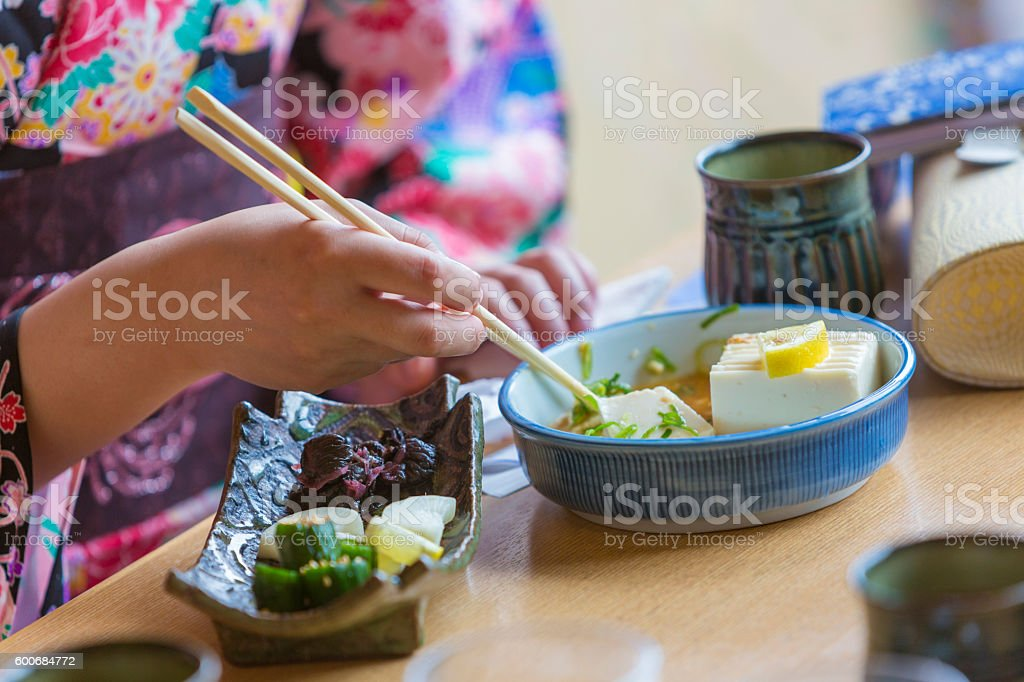 Kimono Wearing Young Japanese Women Eating Noodles in a Restaurant stock photo
