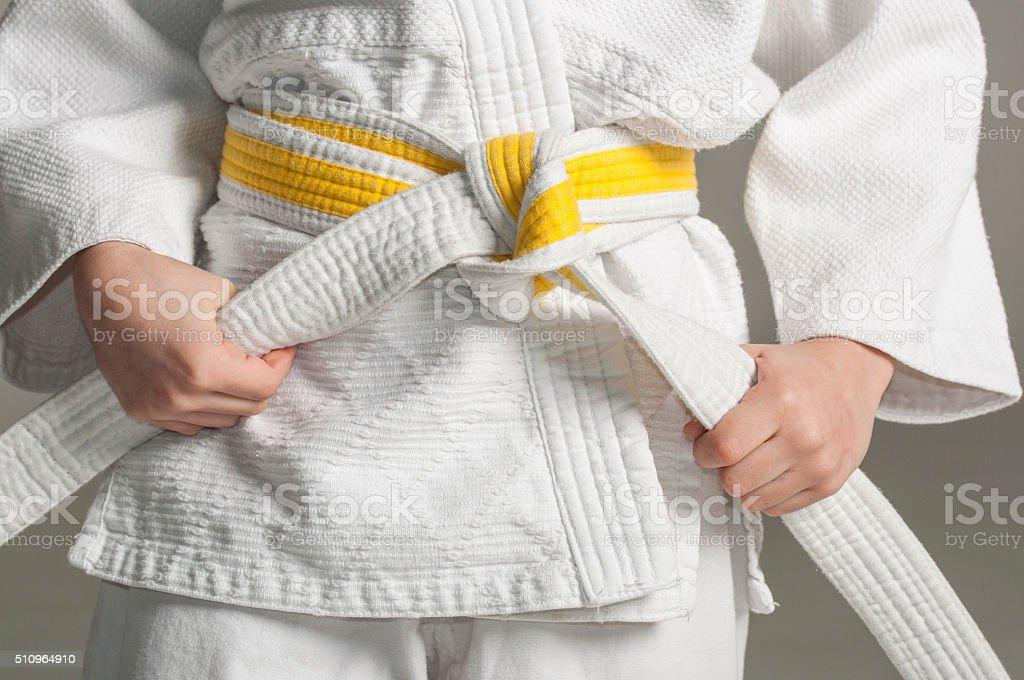 Kimono with yellow belt stock photo