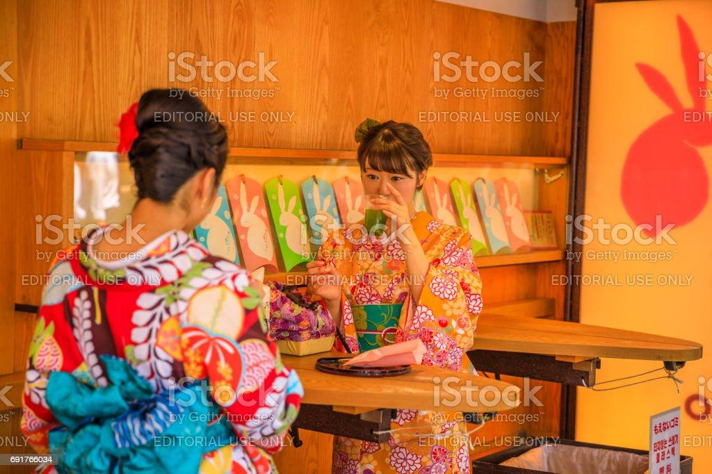 Kimono women drining Amazake stock photo