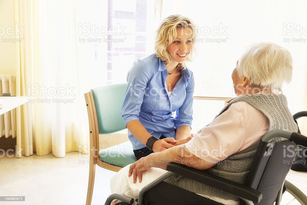 kind care for senio woman patient in wheelchair stock photo