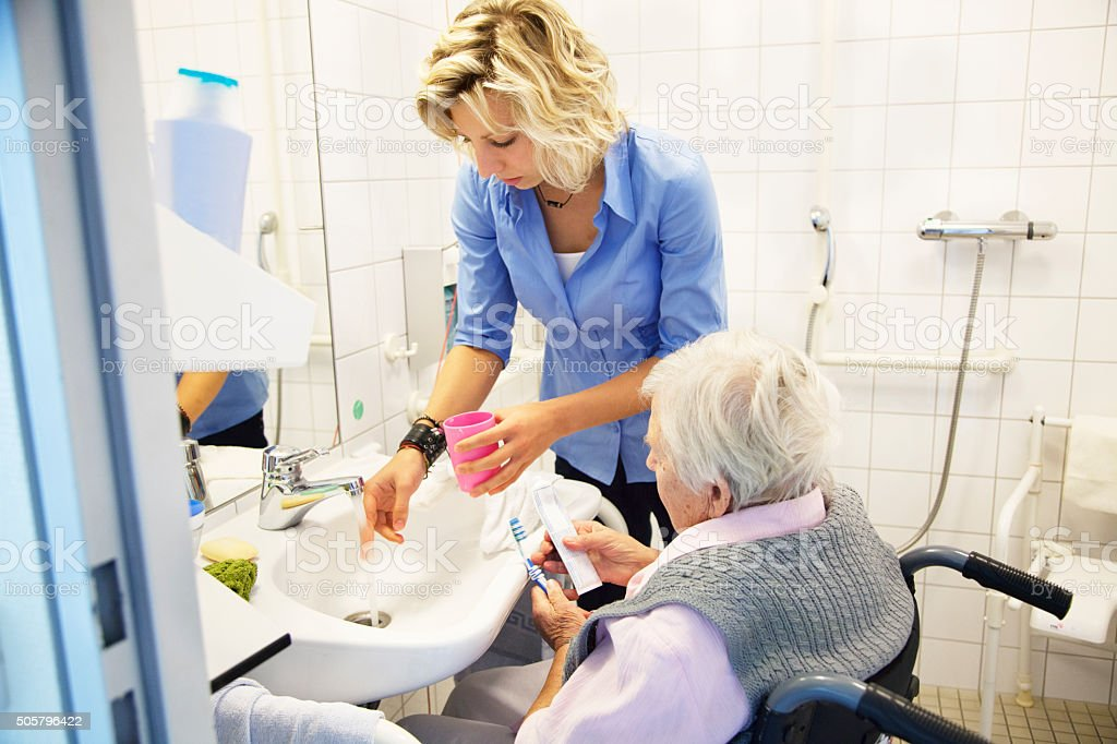 kind care for senior woman stock photo