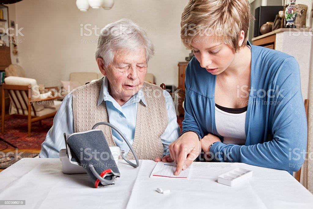 kind caregiver and senior woman stock photo