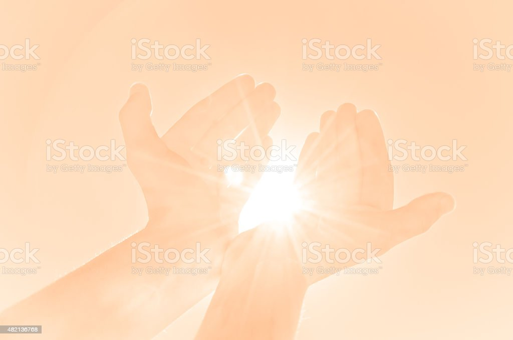 Kind hands offering light stock photo
