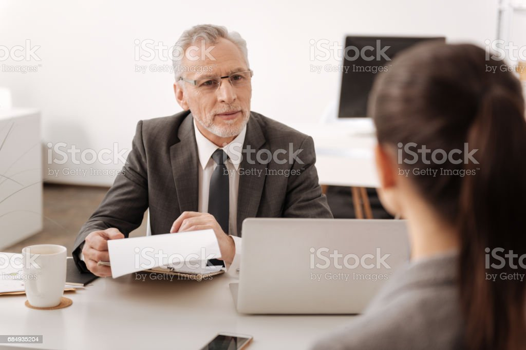 Kind male person looking at his secretary stock photo