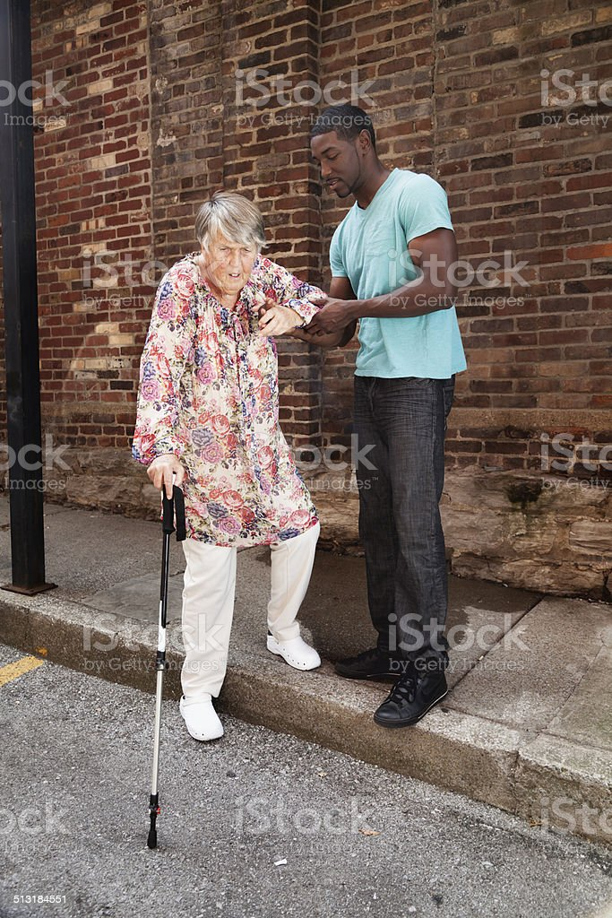 kind support for senior woman stock photo