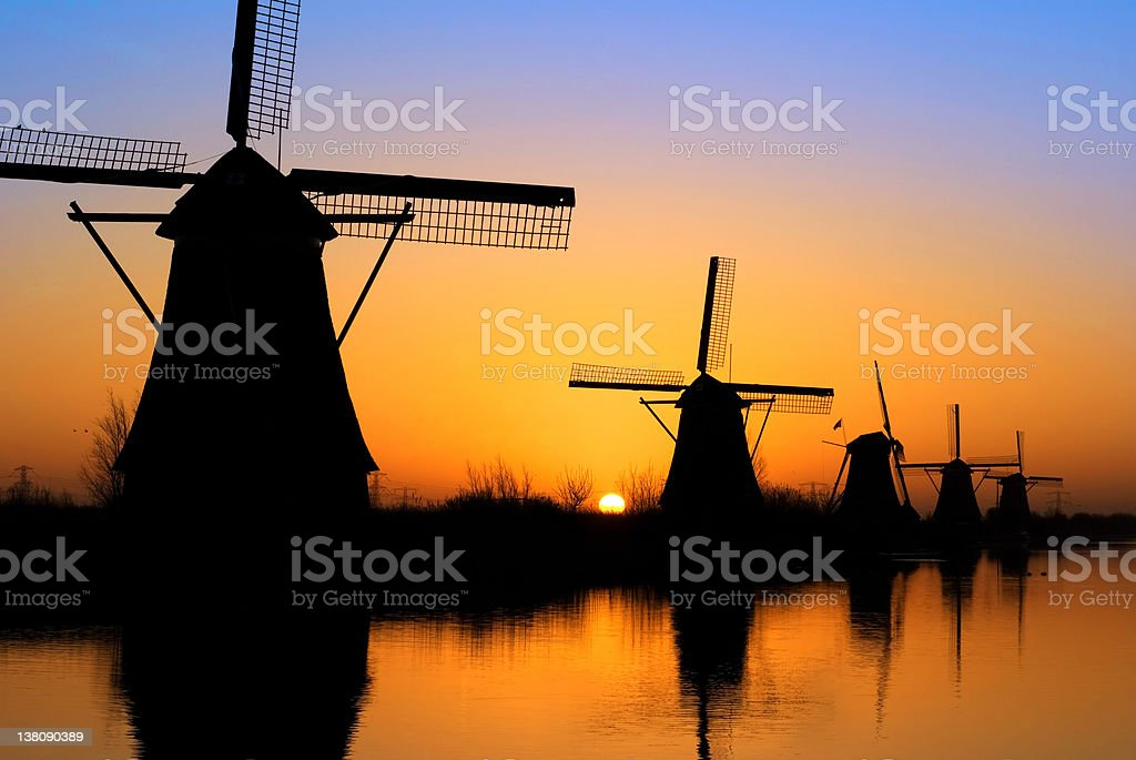 Kinderdijk at sunset with five windmills stock photo