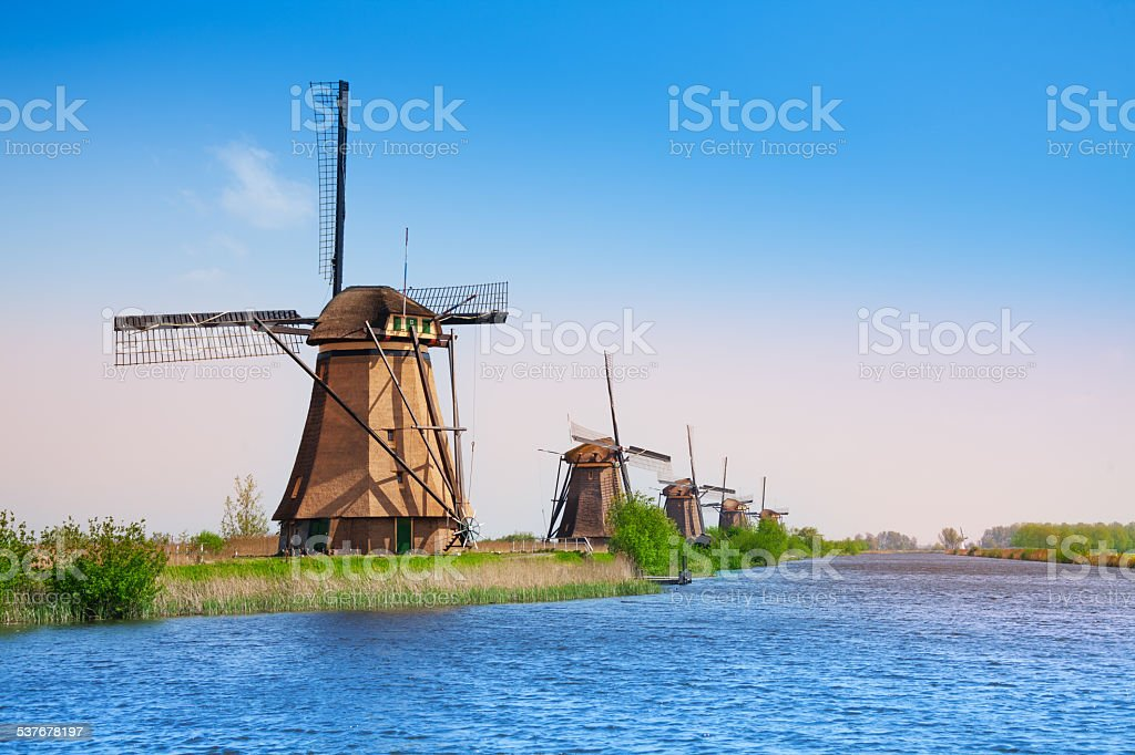 Kinderdijk windmills and canal stock photo