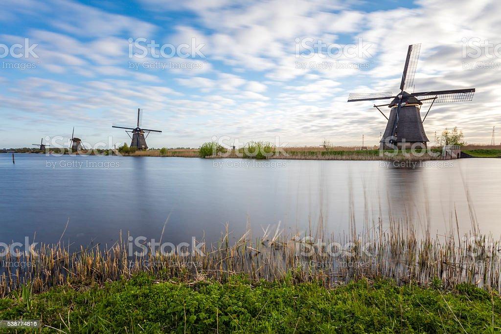 Kinderdijk Windmills In Long Exposure stock photo