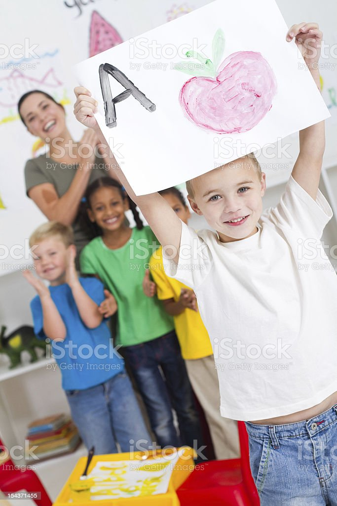 kindergarten boy holding painting royalty-free stock photo