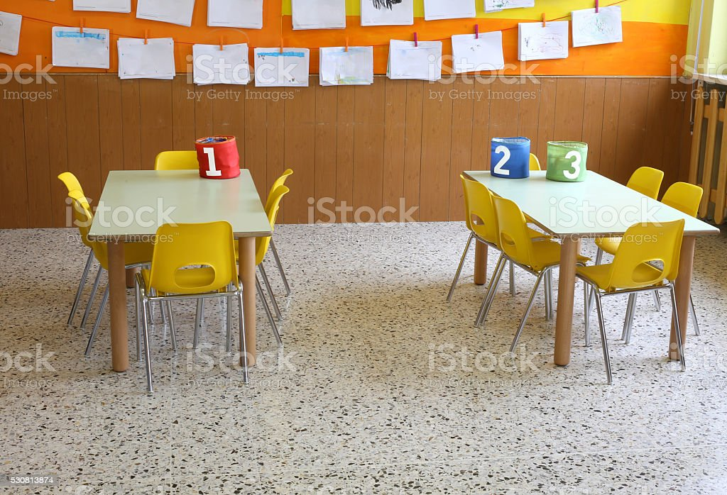 kindergarten class with the yellow chairs and many children's dr stock photo