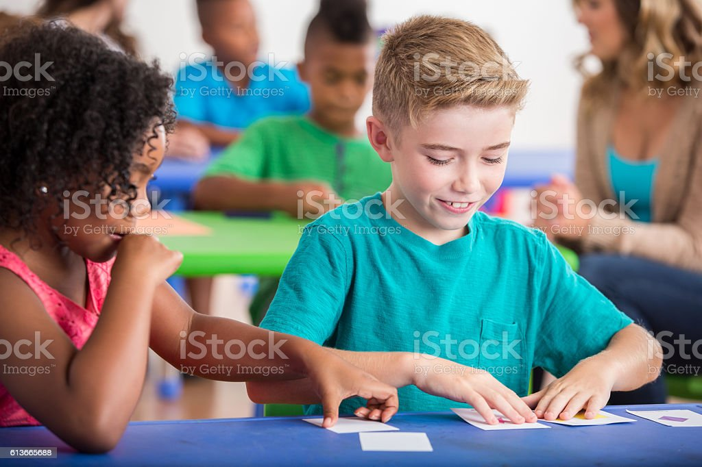 Kindergarten students play with flash cards stock photo