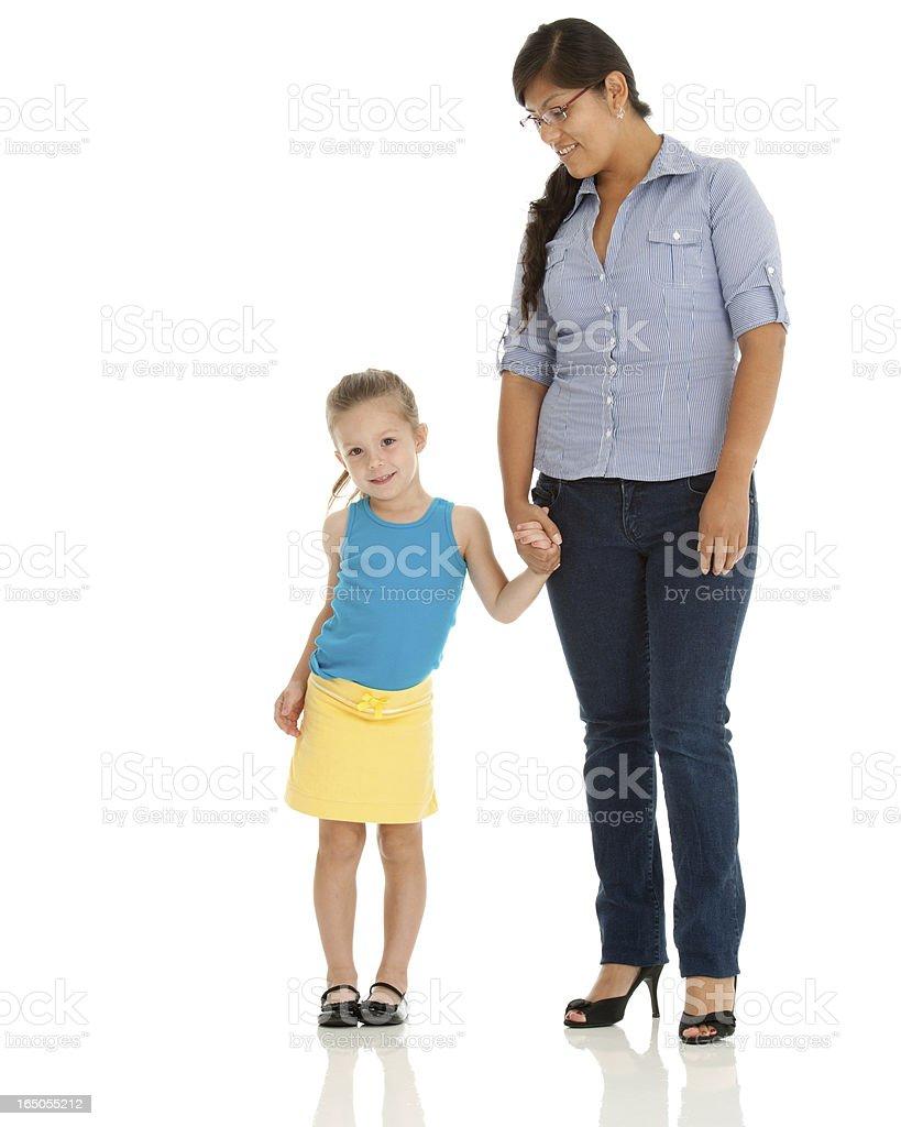 Kindergartner Feels Better Holding Teachers Hand stock photo