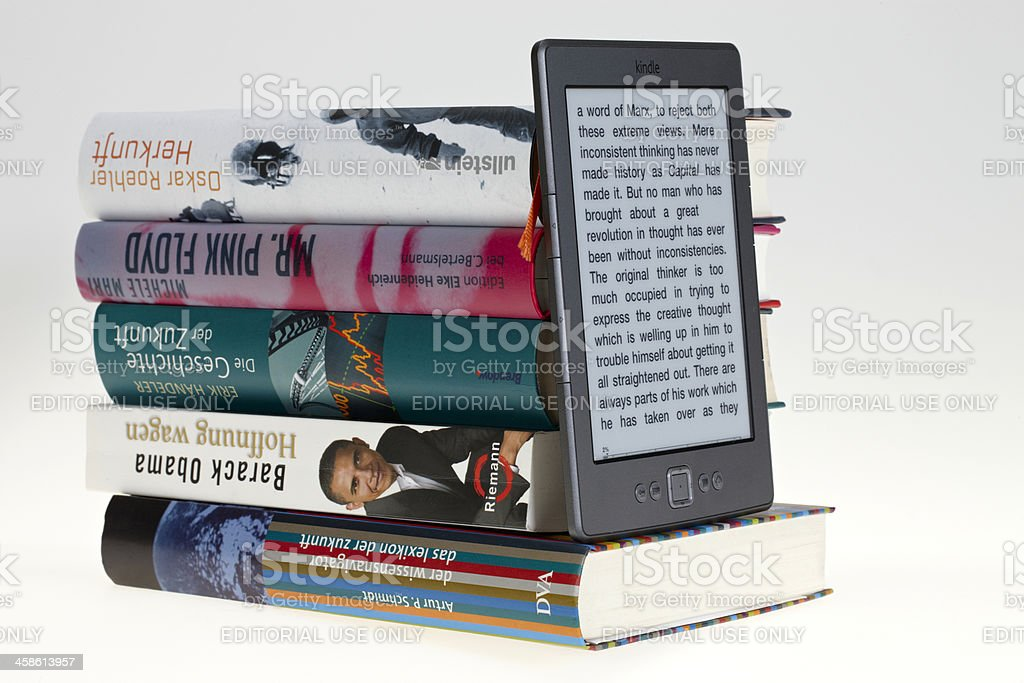 KIndle eBook in front of books stock photo