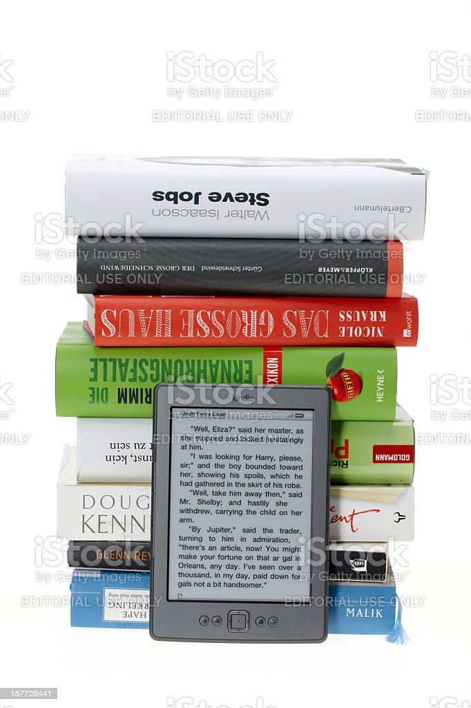 KIndle eBook in front of real books stock photo