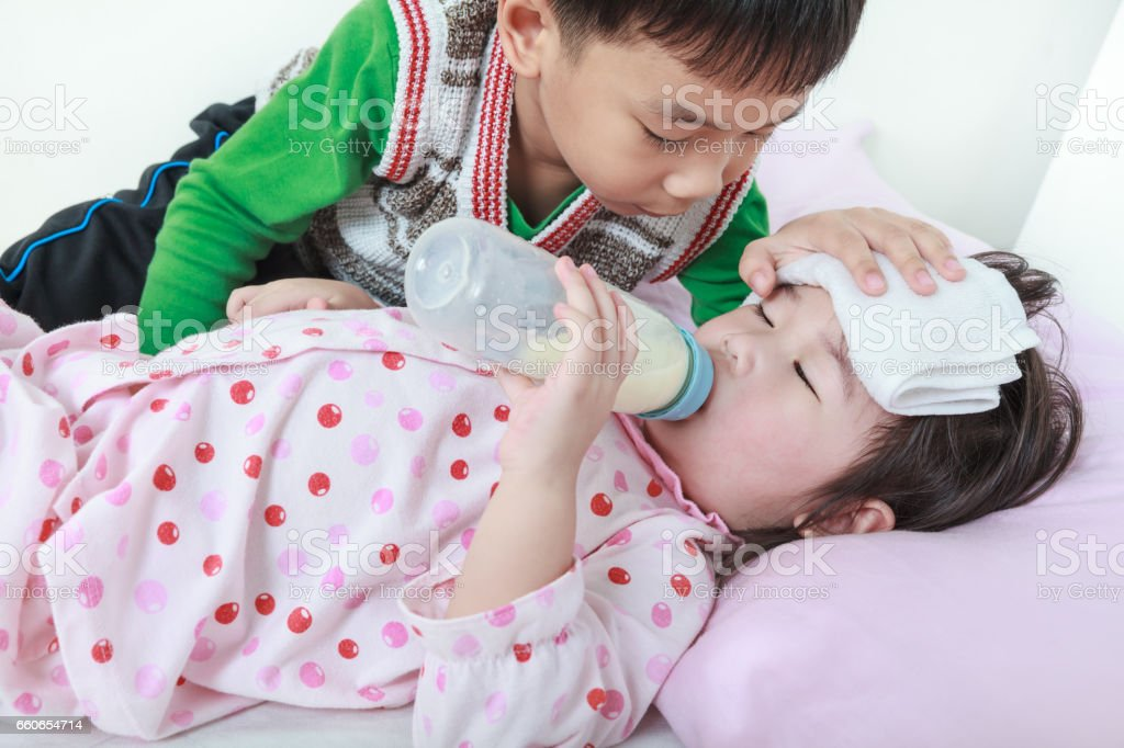 Kindly brother keep vigil over a sick sister of closely. stock photo