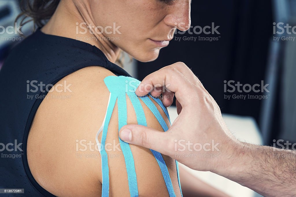 Kinesio tape shoulder treatment stock photo