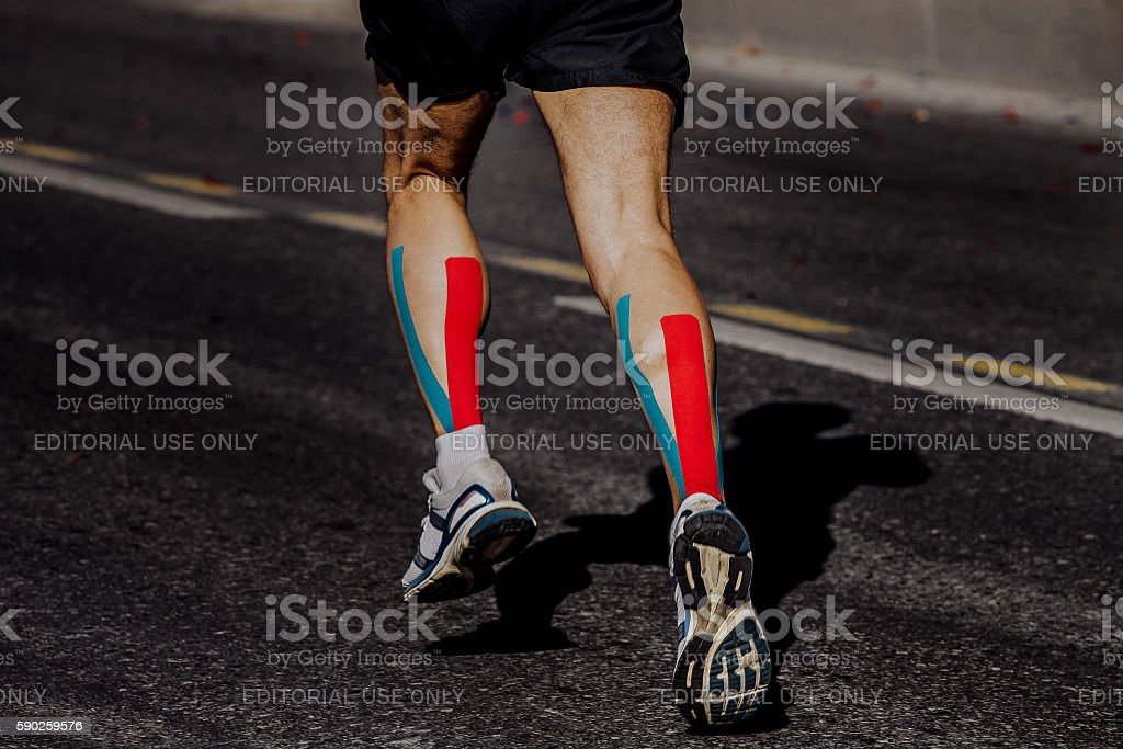 kinesio taping on muscles of calf stock photo