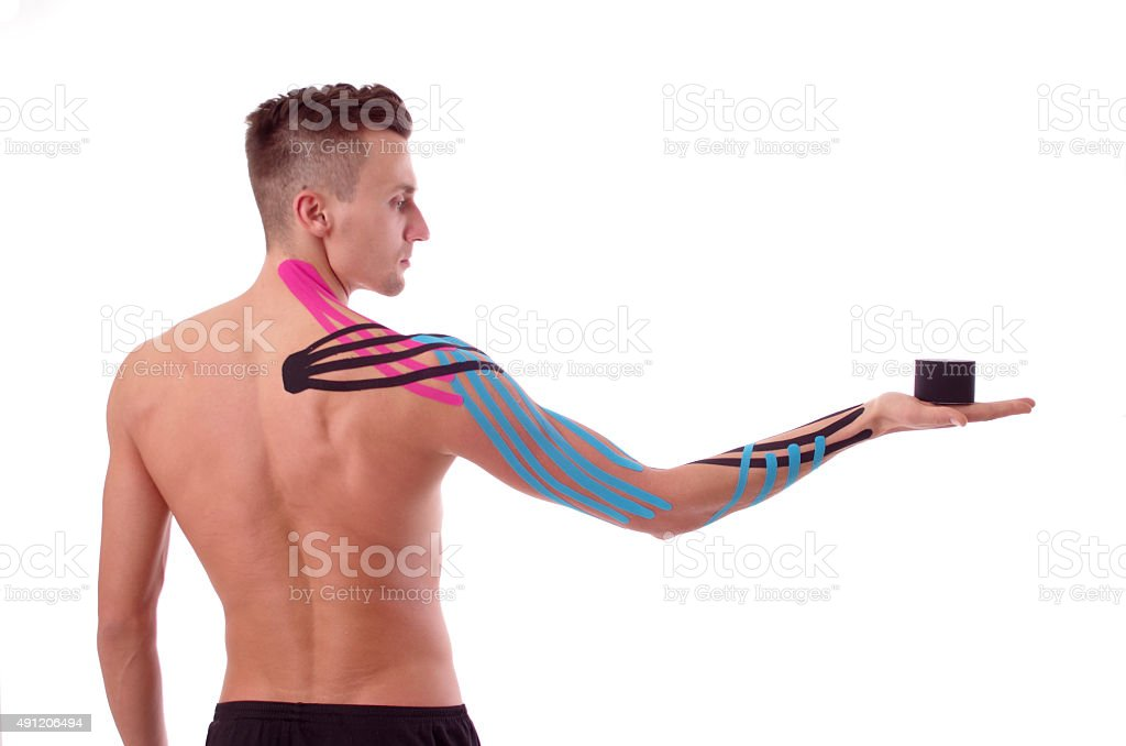 Kinesiology tape on taped arm stock photo