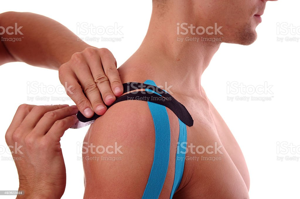 Kinesiology tape, Physiotherapy for sholder pain, aches and tension stock photo