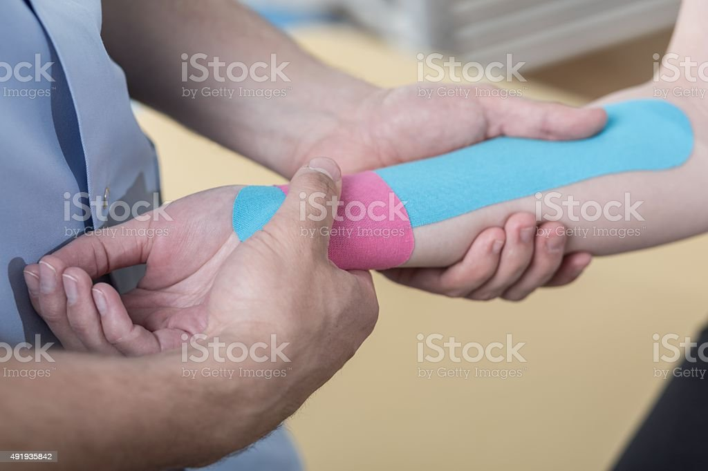 Kinesiology taping after wrist injury stock photo