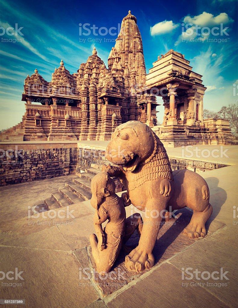 King and lion statue, Kandariya Mahadev temple stock photo