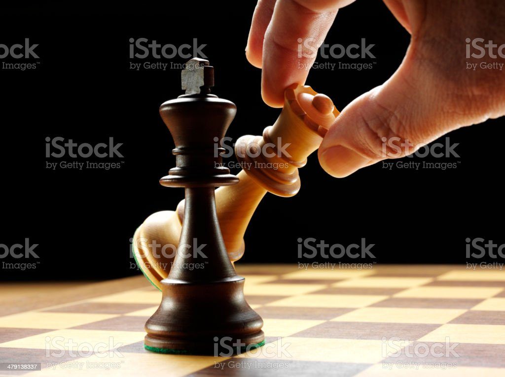 King and Queen Pieces on a Chess Board royalty-free stock photo