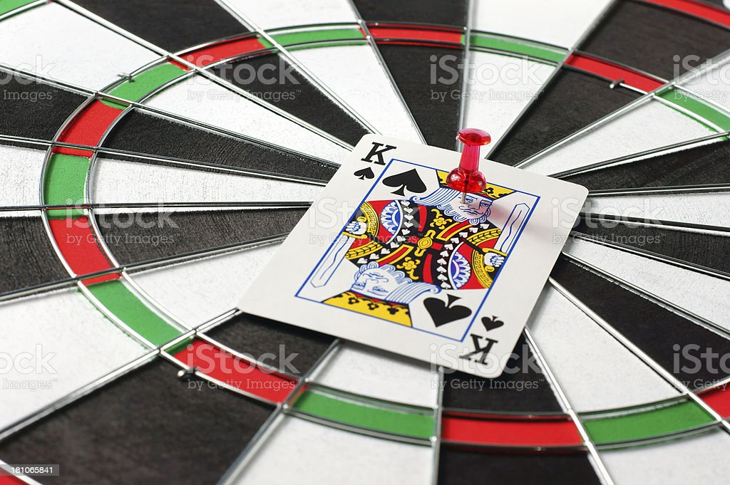 King Card on Dartboard royalty-free stock photo