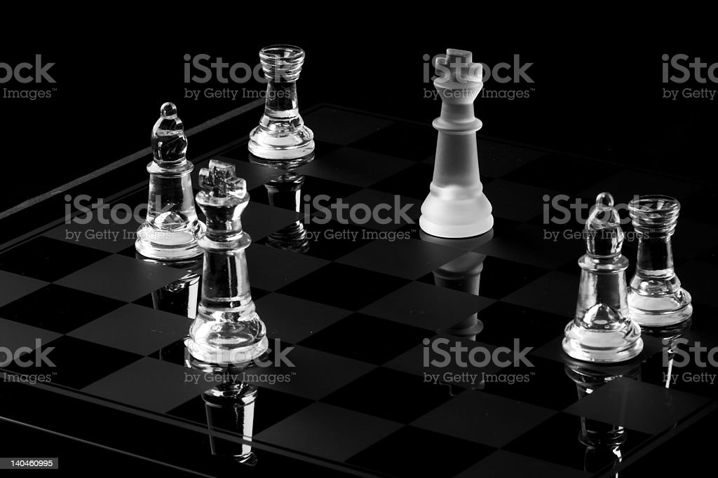 King chess piece being surounded in hostile takeover stock photo