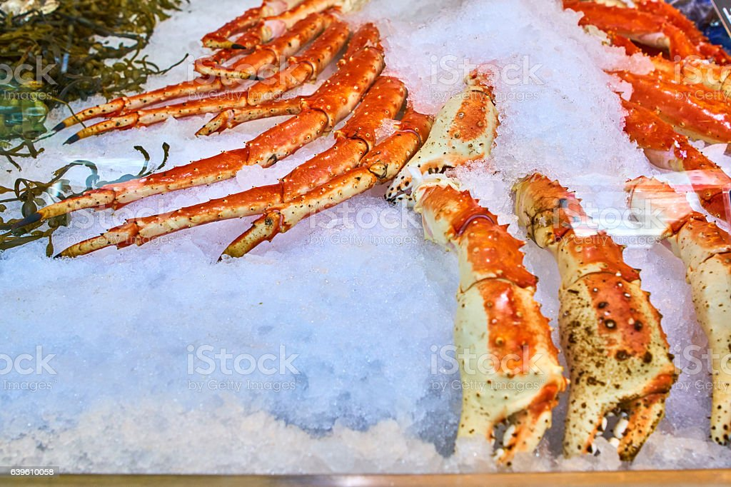 King crab legs on the market stock photo