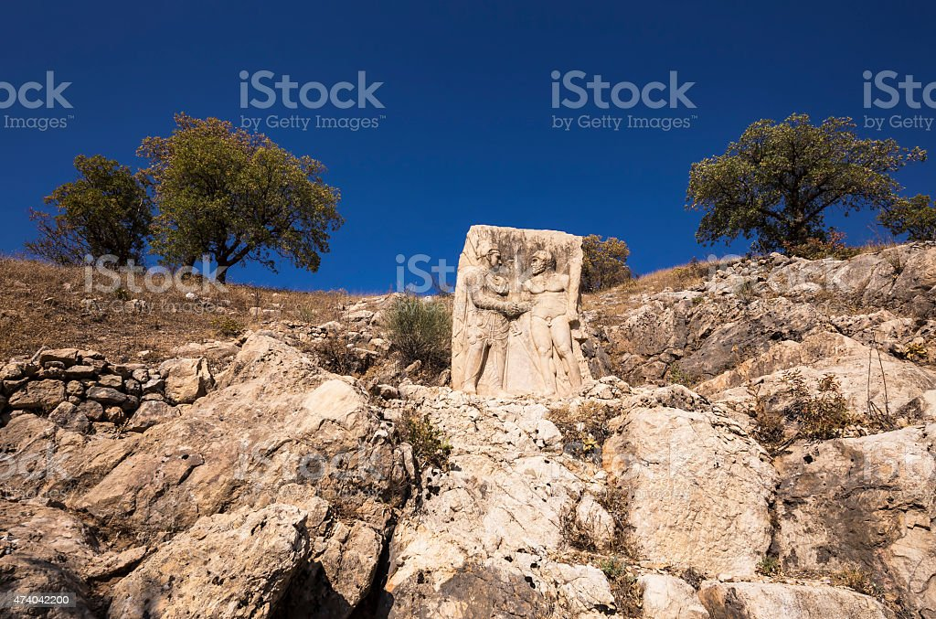 King Mithridates shaking hands with god Herakles stock photo